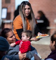 Volunteer Marta Cisneros serves Lisa Ramirez and her son Jay Russell, 9 months, during Homeless Connect at St. Paul's Church on Thursday, January 23, 2020.