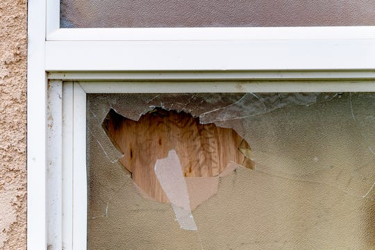 A drive-by shooting cost a 58-year-old man his life Wednesday evening near the corner of Maple and Filbert on Wednesday evening. A  stray bullets shattered this bathroom window and nearly struck the occupant.