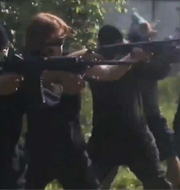 A screenshot from a propaganda video for the Base neonazi group shows William Bilbrough (center) shooting at a training camp in Georgia.