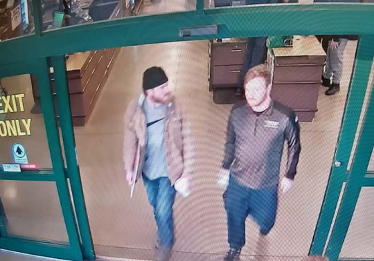 Surveillance footage shows Brian Mark Lemley (right) and Patrik mathews after they purchased rounds of ammunition at a Delaware gun store on January 1, 2020,