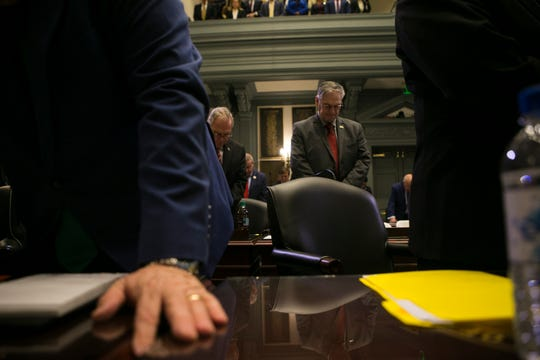 Prayer is held before the Governor's State of the State address Thursday at Legislative Hall.