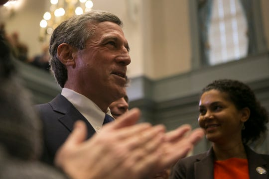 Governor John Carney enters the House Chamber to give his State of the State Address Thursday afternoon at Legislative Hall in Dover.