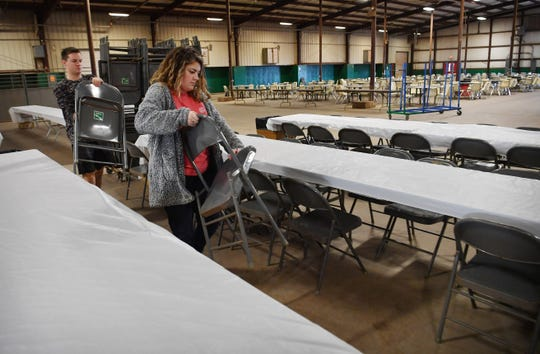 Wichita Falls High School Key Club president Jacob Lang and secretary Lauren Anderson help set up tables and chairs Thursday for the 64th Annual University Kiwanis Club Pancake Festival, Saturday.