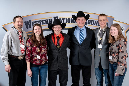 The Columbia County 4-H National Meat Judging team is joined by their coach Todd Taylor, left, during the Western National Round-Up in Denver, CO. The team, consisting of , from left, Faith Baerwolf, Columbus, Hayden Taylor, Arlington, Justin Taylor, Arlington, Zachary Mickelson, DeForest and Samantha Rake, Lodi, captured Top Ten placings in four events.