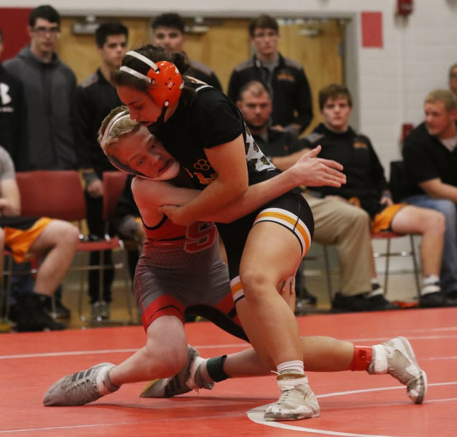 New Lexington's Leilah Castro wrestles Sheridan's Hunter Wallis in the 120-pound weight class in a match she won by pin earlier this season. The National Wrestling Hall of Fame announced Tuesday that she was Ohio's recipient of the Tricia Saunders High School Excellence Award.