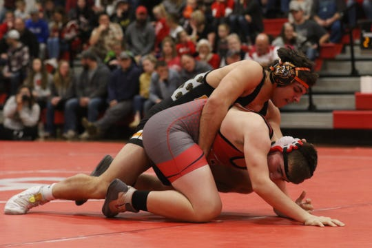 New Lexington's Layne Talbot wrestles Sheridan's Hunter Zizek in the 170 pound weight class earlier this season. Talbot will wrestle for West Liberty in college.