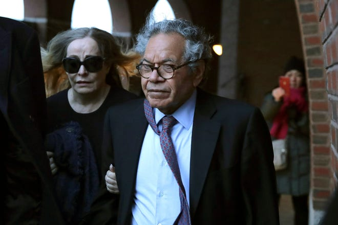 Insys Therapeutics founder John Kapoor, right, departs federal court Thursday, Jan. 23, 2020, in Boston, after he was sentenced to 5 1/2 years in prison for orchestrating a bribery and kickback scheme prosecutors said helped fuel the opioid crisis.