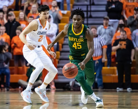 Baylor guard Davion Mitchell dribbles past Oklahoma State guard Lindy Waters III during the first half of their game at Gallagher-Iba Arena.