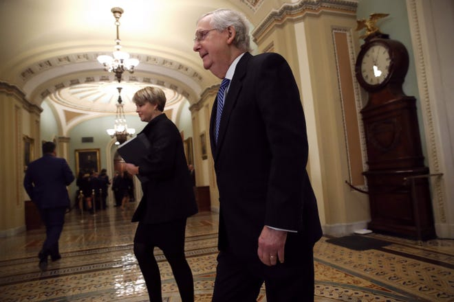 Senate Majority Leader Mitch McConnell, R-KY, walks to the Senate chamber at the U.S. Capitol on Jan. 22, 2020, in Washington, DC. The second day of the impeachment trial of U.S. President Donald Trump took place that day.