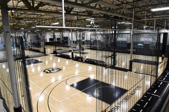 NBA, WNBA and local youth players use basketball courts at Mamba Sports Academy to train.