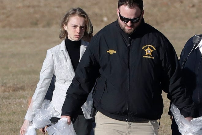 Michelle Carter, left, leaves the Bristol County jail in Dartmouth, Massachusetts, after serving most of a 15-month manslaughter sentence for urging her suicidal boyfriend to kill himself in 2014. The 23-year-old, released three months early for good behavior, will serve five years of probation. Jan. 23, 2020