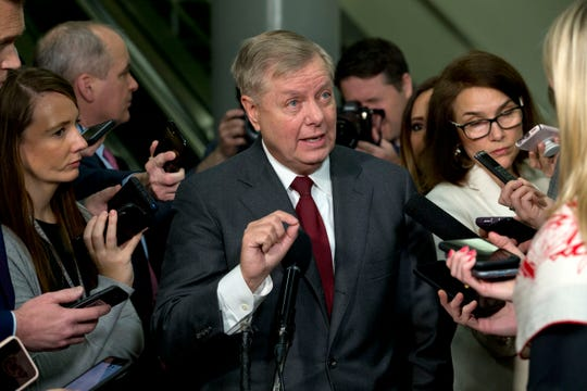 Sen. Lindsey Graham, R-S.C., speaks to the media before attending the impeachment trial of President Donald Trump on charges of abuse of power and obstruction of Congress, Thursday, Jan. 23, 2020, on Capitol Hill in Washington. (AP Photo/Jose Luis Magana) ORG XMIT: DCJL111
