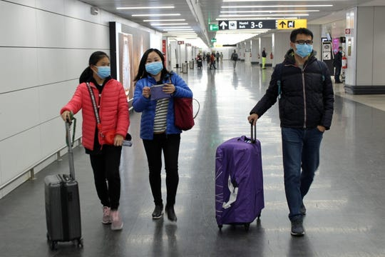 Italy's health ministry says passengers arriving on direct or indirect flights from Wuhan, China, will be checked for symptoms of coronavirus. Some 202 passengers arrived Thursday.