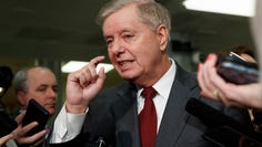Sen. Lindsey Graham, R-S.C., speaks to the media before attending the impeachment trial of President Donald Trump on charges of abuse of power and obstruction of Congress, Thursday, Jan. 23, 2020, on Capitol Hill in Washington. (AP Photo/ Jacquelyn Martin) ORG XMIT: DCJM104