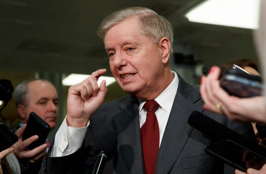 Sen. Lindsey Graham, R-S.C., speaks to the media before attending the impeachment trial of President Donald Trump on charges of abuse of power and obstruction of Congress on Jan. 23, 2020.