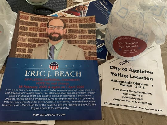 Appleton mayoral candidate Eric Beach is distributing rolls of toilet paper, upper right, as part of his marketing campaign.