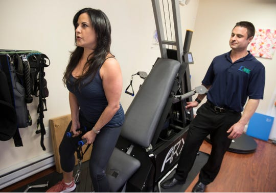 Functionised is a Colts Neck business that provides services like chiropractic care, fitness and wellness advice. Sarah Bandy of Colts Neck works out with business owner Jim Goetz.Colts Neck, NJFriday, January 24, 2020