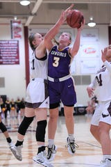 HSU's Parris Parmer (3) goes up for a contested shot against McMurry's Trinity Meador (21) at Kimbrell Arena last week. Parmer is the reigning ASC West Player of the Week after scoring a career-high 27 points in the Cowgirls' 71-56 victory.