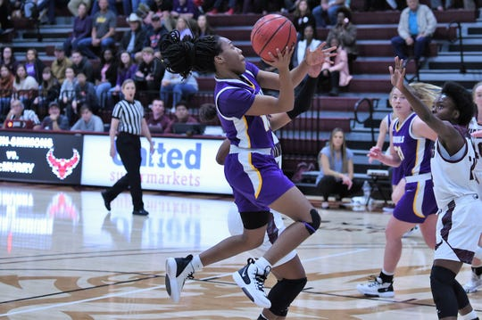 Hardin-Simmons guard Taylor Gaffney (10) goes up for a shot against McMurry. Gaffney finished with 11 points.