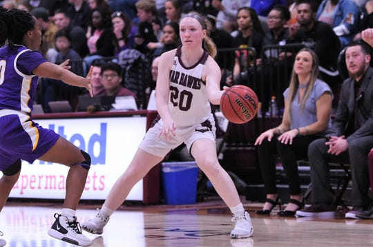 McMurry's Sarah Doherty (20) makes a pass against Hardin-Simmons at Kimbrell Arena on Thursday, Jan. 23, 2020. Doherty had 14 points and three assists in the 71-56 loss.