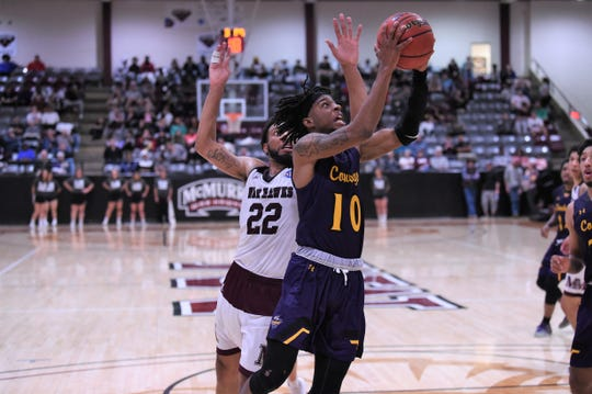 HSU's Kyle Brennon (10) goes up for a shot against McMurry at Kimbrell Arena. The Cowboys won 65-59 to split the season series.