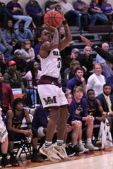 McMurry's Dedrick Berry (3) takes a 3-pointer against Hardin-Simmons at Kimbrell Arena. Berry finished with 11 points, but it wasn't enough in the 65-59 loss.