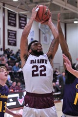 McMurry's Mike Williams (22) goes up for a shot against Hardin-Simmons at Kimbrell Arena. Williams was named American Southwest Conference West Player of the Week after averaging 23.5 points, 10.0 rebounds and 1.5 blocks per game while shooting 56.5 percent from the field.