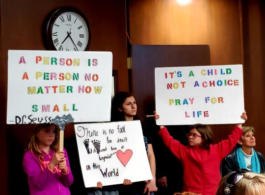 "Children attending Thursday night's Abilene City Council meeting hold signs supporting the idea of making Abilene a ""Sanctuary City for the Unborn."" Jan 23 2020"