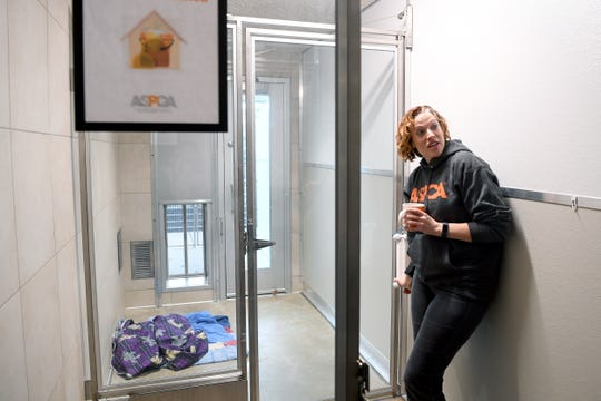 Kristen Collins, Vice President of ASPCA Rehabilitation Services, gives a tour of the Behavioral Rehabilitation Center in Weaverville on Dec. 13, 2019. When dogs first arrive they are placed in a quarantine kennel with double door protection and they own access to outside to prevent the spread of any diseases they may have.