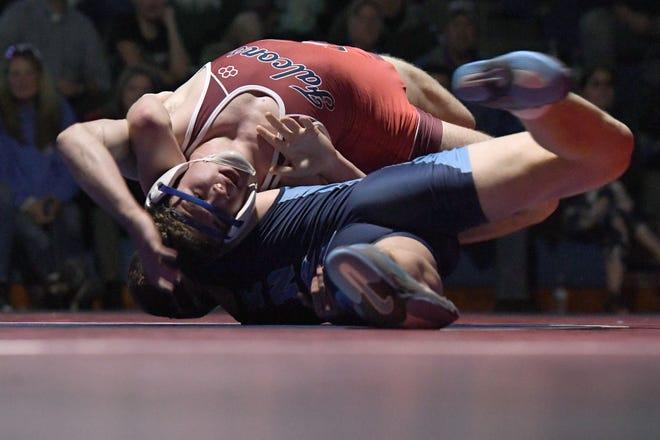 West Henderson's Auden Brennan wrestles Enka's Garrett Pugh in a 170-pound match during their wrestling meet at West Henderson High School on Jan. 23, 2020. Brennan won by decision 10-4.