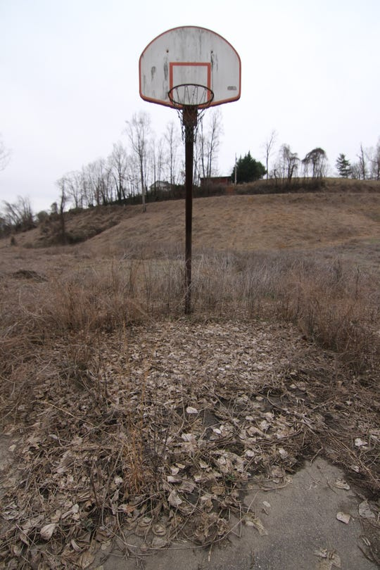 Given the overgrowth on the concrete below what looks to be a usable hoop, a game of H.O.R.S.E. is about the only basketball-related activity possible at the former Marshall rec park site.