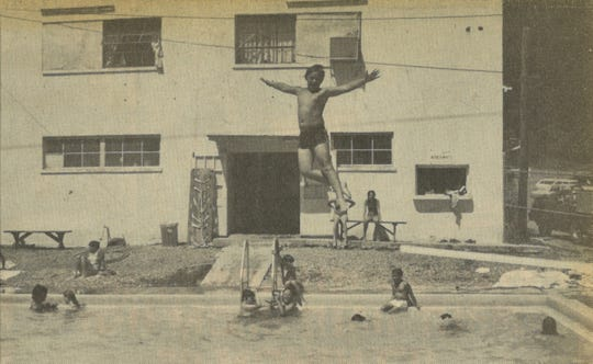 A boy leaps off the diving board at the Marshall pool in this 1980 photo.