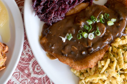 The Jagerschnitzel at Berliner Kindl German Restaurant in Black Mountain is breaded pork schnitzel topped with mushroom sauce and is served with German spaetzle and red cabbage.
