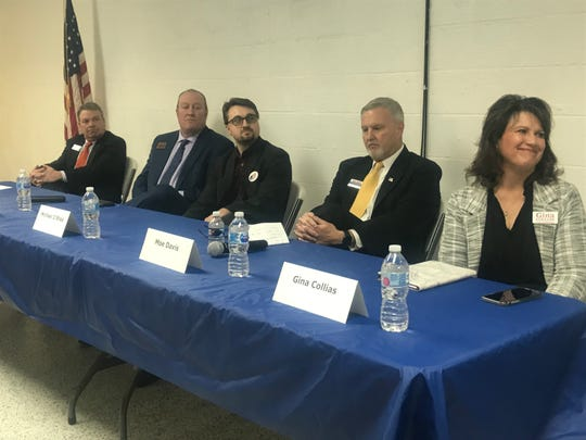 11th District U.S. House Democratic candidates at the start of a Jan. 23, 2020 forum at Buncombe County Democratic Party headquarters in Asheville. Candidates from the left are Steve Woodsmall, Phillip G. Price, Michael O'Shea, Moe Davis and Gina Collias