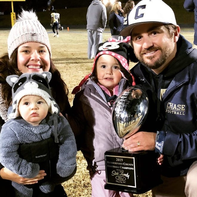 Asheville High's new head football coach Cort Radford and his family.