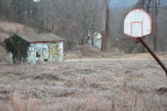 A basketball hoop and block building that served as a spring or pump house remain at the former Marshall Pool site that closed after the summer of 1988.