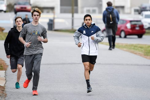 David Cordero runs with his team at Roberson January 22, 2020.