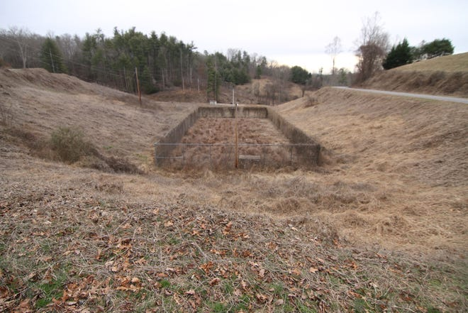 A view of what was once tennis courts shows the impact of years of neglect at the former recreation park site near Derringer and Skyway drives in Marshall.