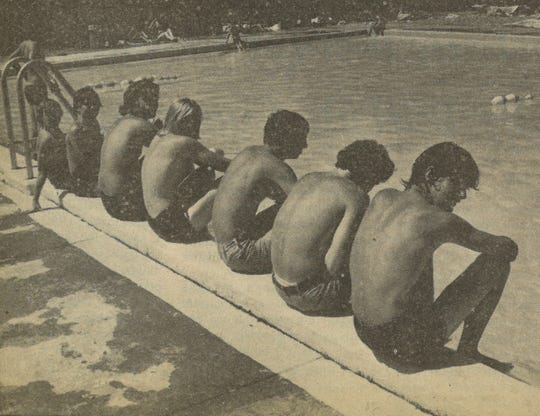 Boys sit at the edge of the Marshall pool in this photo taken from the July 3, 1980, edition of the News-Record.