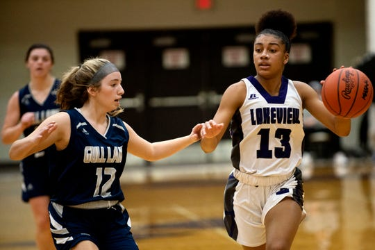 Lakeview junior Brazyll Watkins (13) drives the ball as Gull Lake junior Cora Howe (12) covers her on Friday, Jan. 24, 2020 at Lakeview High School in Battle Creek, Mich.