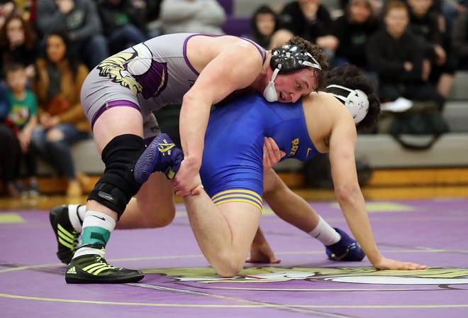 Recent North Kitsap High School graduate Cache Holmes plans to compete in football and wrestling at Southern Virginia University.