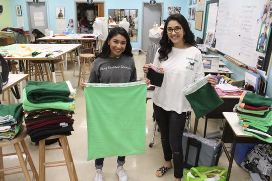 King High School senior council officer Crystal Salazar and student council president Ciara Martinez hold cloth pouches that they helped make, on Friday, Jan. 24, 2020. The pouches will hold marsupials orphaned or displaced by the Australian wildfires and will be donated to a nonprofit called Wildcare Australia.