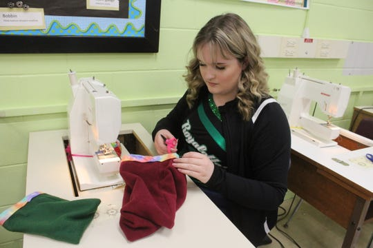 King High School junior Paige Hart makes a cloth pouch that will hold a marsupial orphaned or displaced by the Australian wildfires, on Friday, Jan. 24, 2020. Student council members and fashion design students collaborated to make the pouches, which will be donated to a nonprofit called Wildcare Australia.