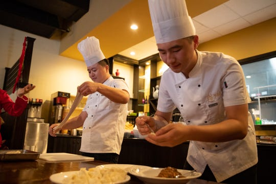 Two cooks at Dao Authentic Asian Cuisine put on a food demonstration as they celebrate the Chinese Lunar New Year on Jan. 24, 2020.