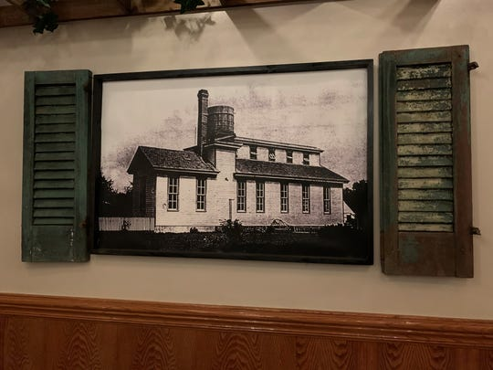 A new addition to the dining room at Botto's is an old photograph of the family's original sausage factory.