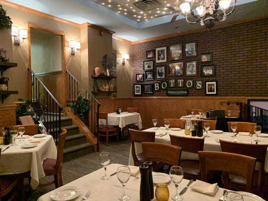 The upstairs dining room features a wall of old family photos.