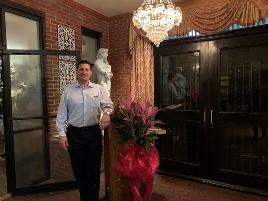 Robert Botto Jr. stands in the lobby of Botto's Italian Lne Restaurant.