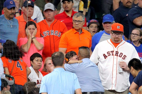 May 29, 2019: A young fan is taken up to the concourse to receive medical attention after being hit by a foul ball by Chicago Cubs center fielder Albert Almora Jr. (5) during the fourth inning against the Houston Astros at Minute Maid Park.