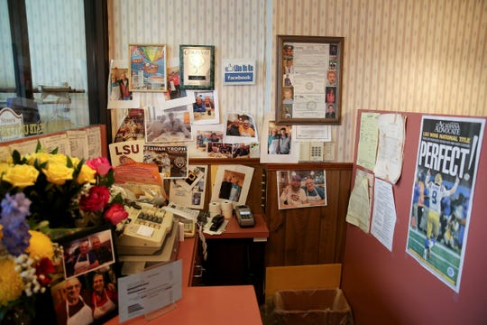 The register corner is decorated with photos and Louisiana State University memorabilia, Chris Stone's favorite college, Friday, Jan. 24, 2020, at Stone Family Restaurant in Cheviot. The neighborhood restaurant closed on Saturday after first opening in 1962.