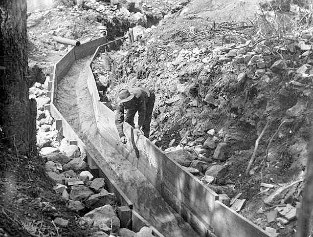 Sluice for separation of gold from dirt using water